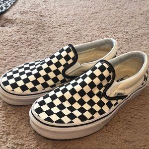 Checkered Vans slip-ons